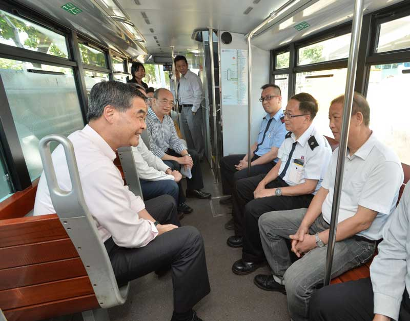 the HK mayor visit HK trams bus air conditioner